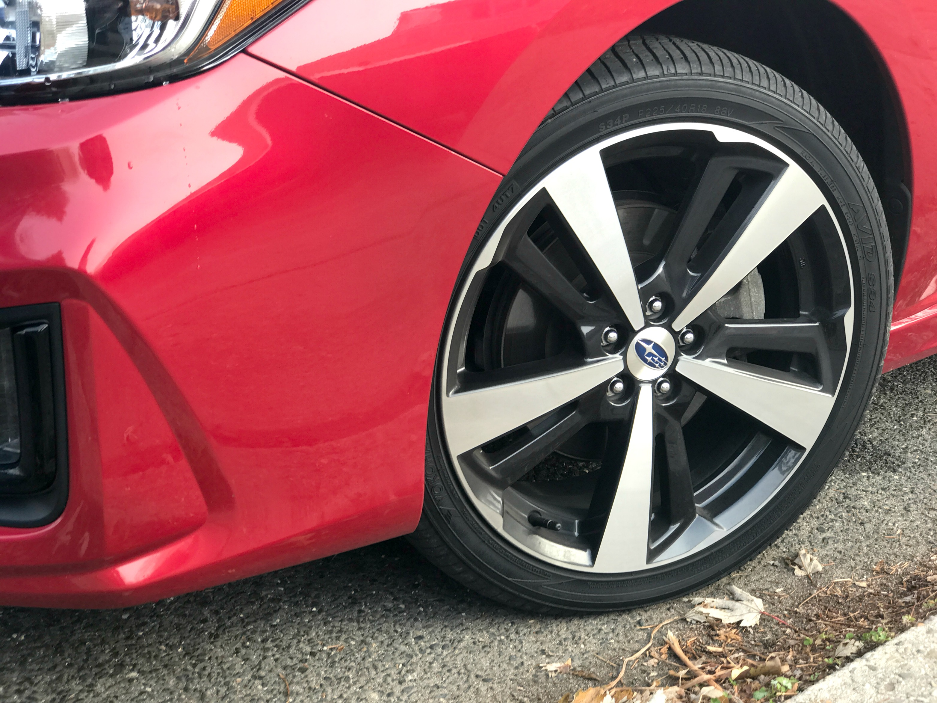Tires of a red compact AWD sedan