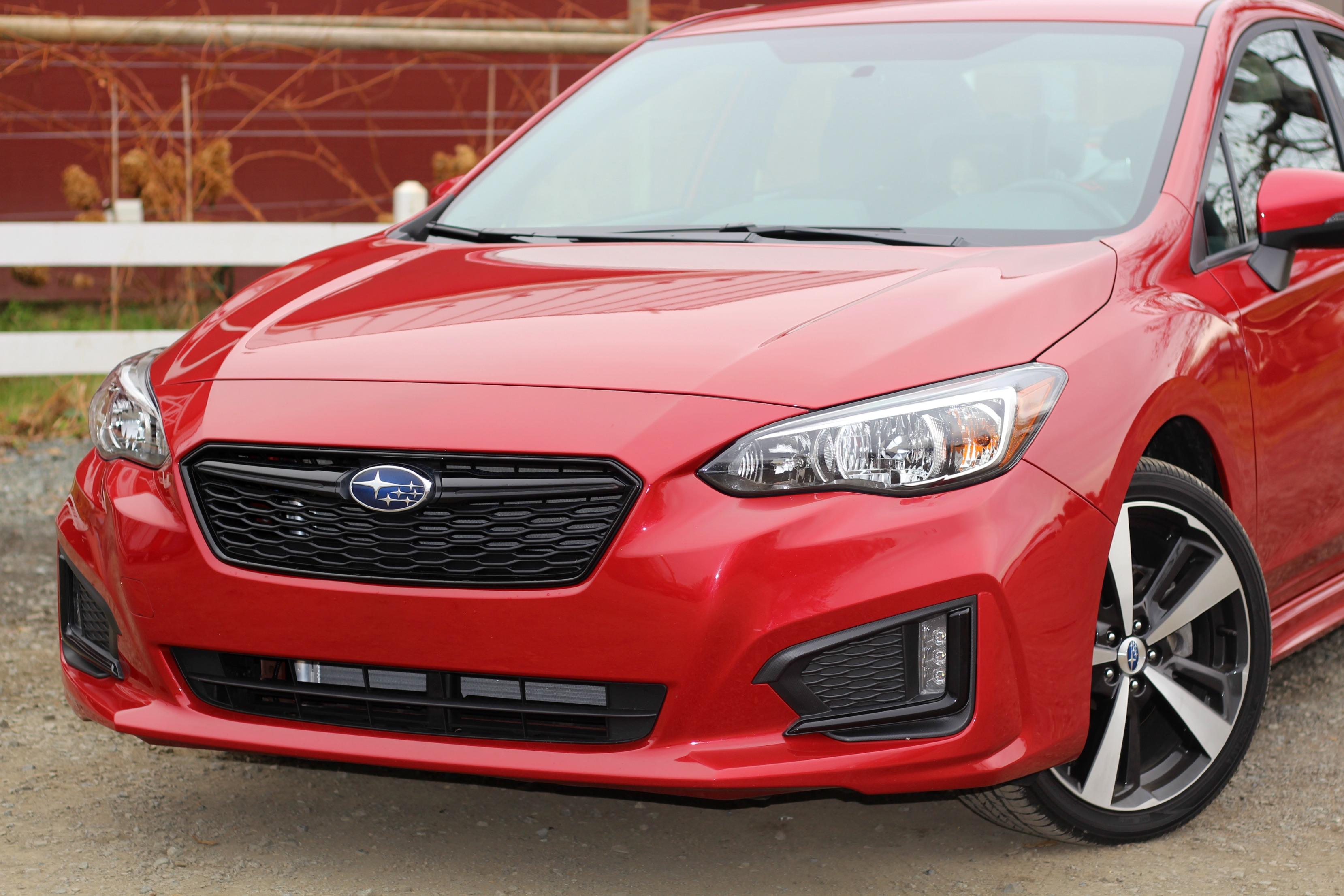 Red 2017 Subaru Impreza compact AWD sedan
